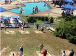 View larger image of An aerial view of the horseshoe courts and swimming pool at SEA GROVE CAMPING RESORT image #1