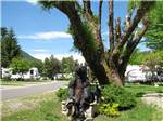 View larger image of Trailers camping with statue of a bear at BLUE ANCHOR RV PARK image #2