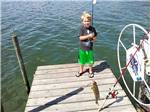 View larger image of Kid fishing at CAMP CHAUTAUQUA CAMPING RESORT image #2