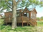 View larger image of Log cabin with deck at LAKELAND CAMPING RESORT image #5