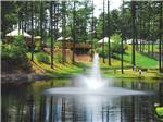 View larger image of A fountain in the lake at NORMANDY FARMS FAMILY CAMPING RESORT image #2
