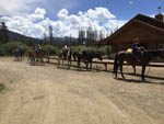 View larger image of A group of people on horses at WINDING RIVER RESORT image #5