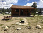 View larger image of A wooden building with a fire pit at WINDING RIVER RESORT image #6