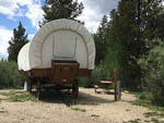 View larger image of The front view of an old covered wagon at WINDING RIVER RESORT image #7