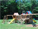 View larger image of The wooden playground area at CRAZY HORSE FAMILY CAMPGROUND image #5