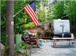 View larger image of A travel trailer nestled among trees at CRAZY HORSE FAMILY CAMPGROUND image #7