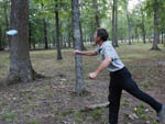View larger image of Man throwing blue disc at disc golf course in the woods at BULL RUN REGIONAL PARK image #4