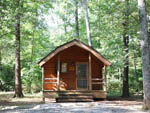 View larger image of Wooden cabin in densely wooded area with parking spot before it at BULL RUN REGIONAL PARK image #6
