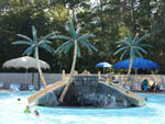 View larger image of Decorative island with slides at waterpark surrounded by pool with children playing at BULL RUN REGIONAL PARK image #10