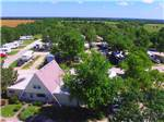 View larger image of Aerial view over campground at ALL SEASONS RV PARK image #11