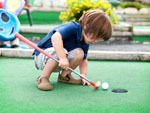 View larger image of Kid playing miniature golf at HERSHEY ROAD CAMPGROUND image #4