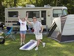 View larger image of Couple camping at HERSHEY ROAD CAMPGROUND image #6