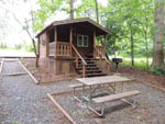 View larger image of Cabin with deck at MIDWAY CAMPGROUND  RV RESORT image #7