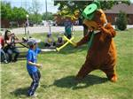 View larger image of Yogi and kid at YOGI BEARS JELLYSTONE PARK CAMP-RESORT image #10