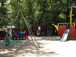 View larger image of The pirate ship playground and swing set at HIDDEN ACRES FAMILY CAMPGROUND image #7