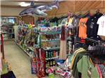 View larger image of General Store interior with clothing food and groceries and an inflatable shark hanging from the ceiling at SHERWOOD FOREST CAMPING  RV PARK image #4