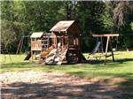 View larger image of Playground with swing set at SHERWOOD FOREST CAMPING  RV PARK image #5