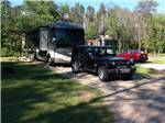 View larger image of RVs camping at shady site at SHERWOOD FOREST CAMPING  RV PARK image #8