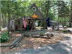 View larger image of Rustic office shaded by trees at LAKE PEMAQUID CAMPGROUND image #2