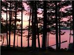 View larger image of 3 young people fishing from dock at LAKE PEMAQUID CAMPGROUND image #8