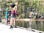 View larger image of Campground reflected on the water at LAKE PEMAQUID CAMPGROUND image #9