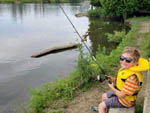 View larger image of Young boy with sunglasses fishing at BINGEMANS CAMPING RESORT image #2
