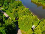 View larger image of Aerial view of riverfront section at BINGEMANS CAMPING RESORT image #4
