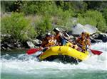 View larger image of Family paddling in bright yellow raft on white water rapids at SAC-WEST RV PARK AND CAMPGROUND image #10