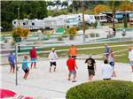 View larger image of Men playing volleyball at MIAMI EVERGLADES RESORT image #2