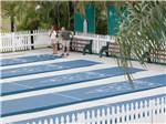 View larger image of Couple playing shuffleboard at MIAMI EVERGLADES RESORT image #5