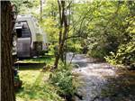 View larger image of Trailers camping next to stream at FORT TATHAM RV RESORT  CAMPGROUND image #5