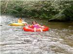 View larger image of Kids floating down the river at FORT TATHAM RV RESORT  CAMPGROUND image #8