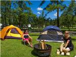 View larger image of Girls in tents camping at HOLIDAY TRAV-L-PARK image #4