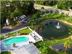 View larger image of Aerial view of large pond with fountain community pool and lush landscaping at BONITA LAKE RV RESORT image #1