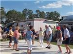 View larger image of Group of campers participating in community dance at BONITA LAKE RV RESORT image #3
