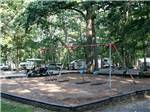 View larger image of The playground area with swings at DRUMMER BOY CAMPING RESORT image #4