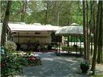 View larger image of One of the camping areas with trees at DRUMMER BOY CAMPING RESORT image #5