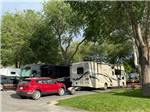 View larger image of RVs and trailers at campground in rain at MOUNTAIN SHADOWS RV PARK  MHP image #2