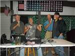 View larger image of Men singing at SUN N SHADE RV RESORT image #10