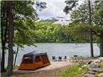 View larger image of Couple camping in RV at STONE MOUNTAIN PARK CAMPGROUND image #2