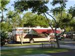 View larger image of Tan white and red RV at REDDING PREMIER RV RESORT image #6