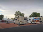 View larger image of Campers parked in sites with picnic table at RIVIERA RV PARK image #5