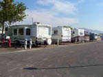 View larger image of Row of RVs in sites off of paved road at RIVIERA RV PARK image #7