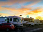 View larger image of Sunset over a row of RVs at RIVIERA RV PARK image #9