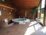 View larger image of Indoor hot tub with wood walls at CAPILANO RIVER RV PARK image #8