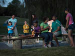 View larger image of A group of people making Smores at HERSHEYPARK CAMPING RESORT image #5