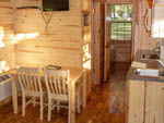 View larger image of The kitchen area inside of one of the cabins at HERSHEYPARK CAMPING RESORT image #9