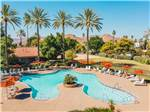 View larger image of An aerial view of one of the three pools at GOLDEN VILLAGE PALMS RV RESORT - SUNLAND image #11