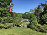 View larger image of Flagpole at office at COOPERSTOWN SHADOW BROOK CAMPGROUND image #3