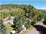 View larger image of Aerial view over campground trees and mountainside at PAGOSA RIVERSIDE CAMPGROUND image #6